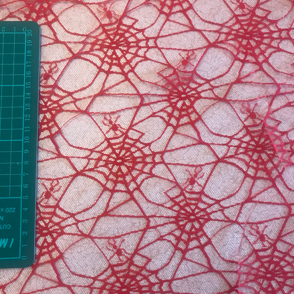 Red mesh spiderweb polyester sheer fabric (per half metre)