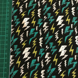 Black lightning bolt glow in the dark cotton jersey knit fabric (per half metre)