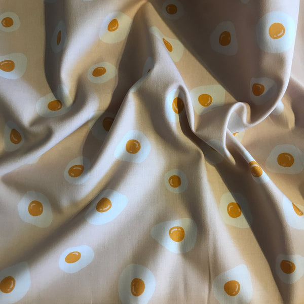Peach fried egg food patterned cotton woven fabric (per half metre)
