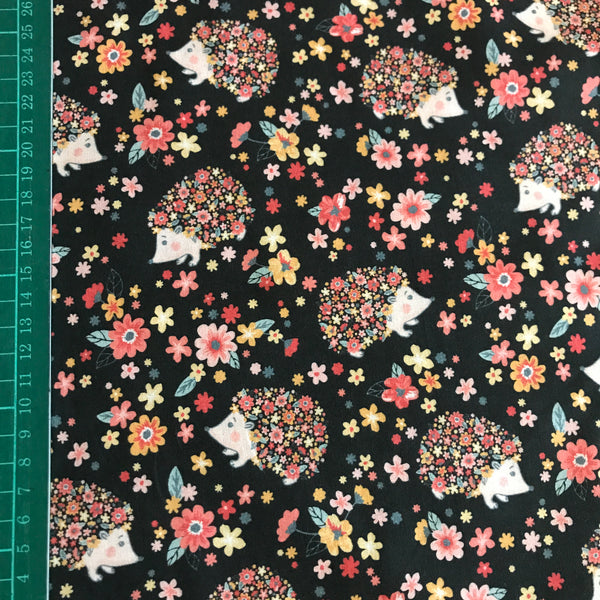 Black floral hedgehog patterned cotton woven fabric (per half metre)
