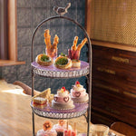 Load image into Gallery viewer, Ice Cream Afternoon tea display of different cakes and savoury items, with two glasses of prosecco