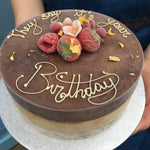 Load image into Gallery viewer, Ice cream cake with chocolate ganache, writing in chocolate and berry decoration