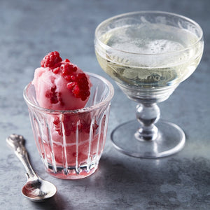 Raspberry, Rosewater & Prosecco sorbet served with a glass of prosecco