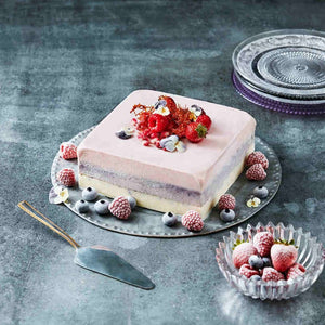 Square ice cream cake with frozen berries