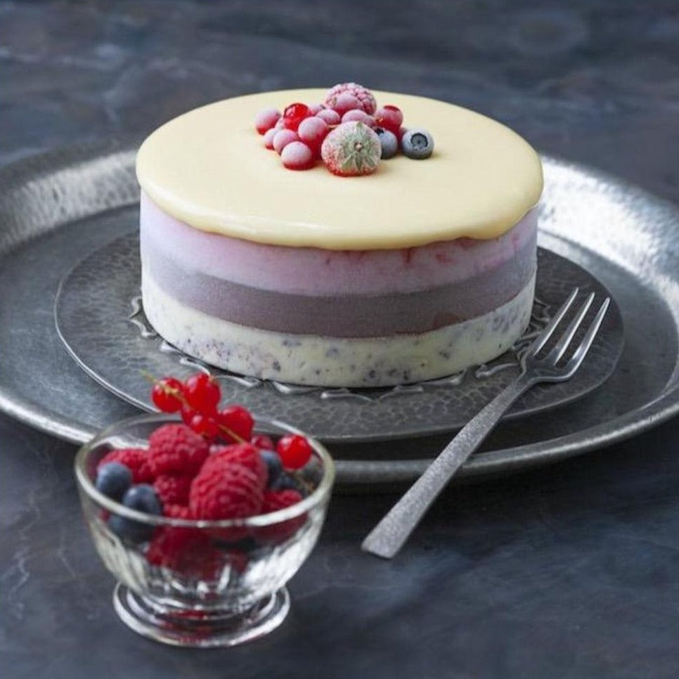 Ice cream cake with white chocolate ganache and berries