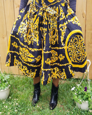 Women wearing a Black and Gold African Print Short Maxi Skirt