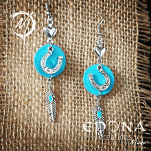 Load image into Gallery viewer, Blue with enamel feather Leather, Horseshoe and feather tassle earrings handmade custom jewellery and gifts epona creations by monika made in australia