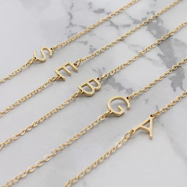 Single sideways initial necklace