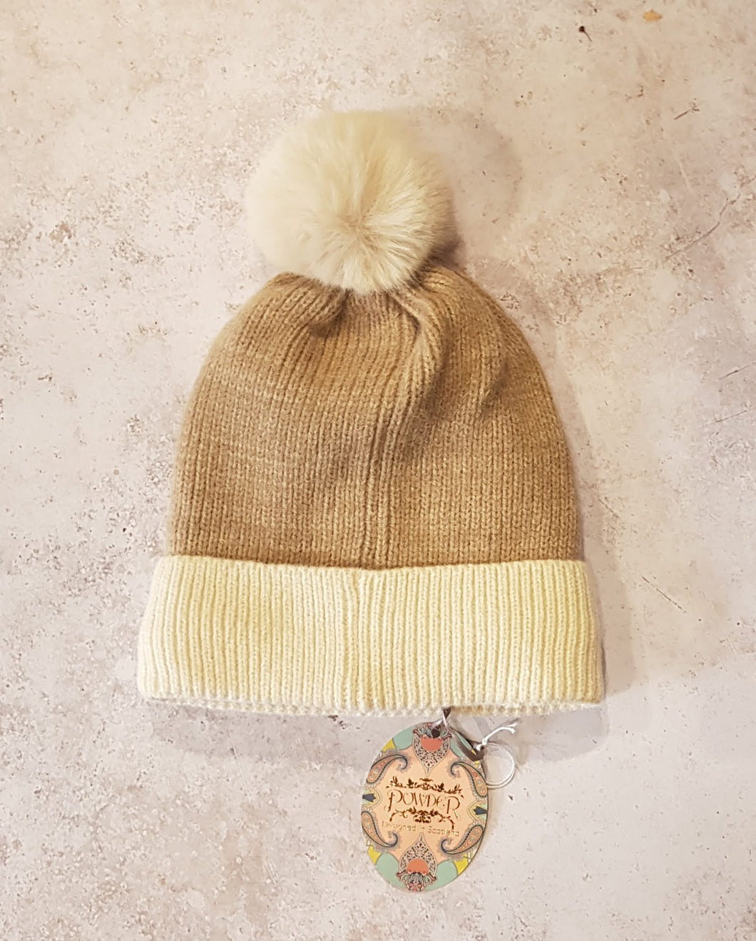 STONE AND CREAM POMPOM HAT