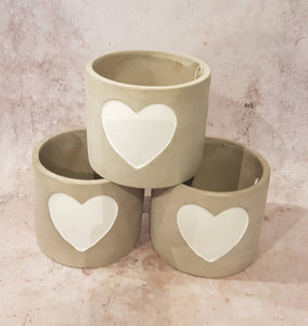 CEMENT PLANT POT WITH WHITE HEART DETAIL
