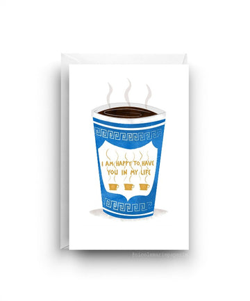 White card. Tall blue cup of coffee with steam coming out of the top. Cup has a design on it with the text