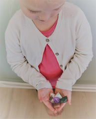 Photo of girl holding crystals