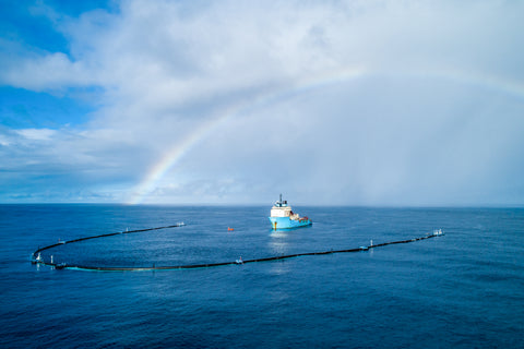 The Ocean Cleanup Image of one of the vessels cleaning up the ocean with a beautiful rainbow in the background
