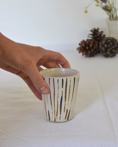 small handpainted cup with brown stripes