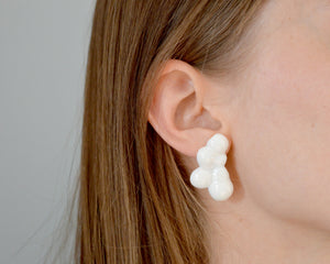 Light porcelain earrings in shapes of clouds