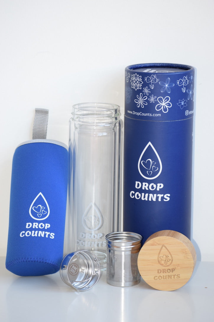 Everything that is included when you shop a DropCounts bottle - Double walled glass bottle, a neoprene sleeve with handle, 2 stainless steel strainers - 1 small 1 big, bamboo lid with steel interior and silicon seal, a gift ready tube box as packaging with option to write a message.