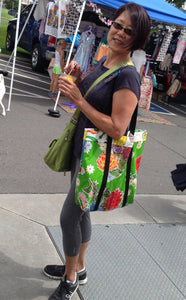 Woman with green Tallulah Art•Head oilcloth market bag over her shoulder