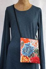 Load image into Gallery viewer, Orange oilcloth cross-body bag from Tallulah Art•Head on mannequin