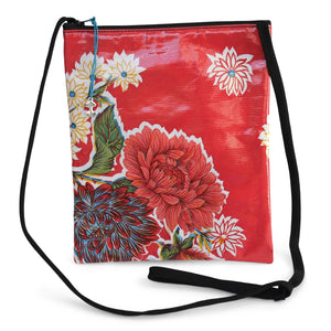Red oilcloth cross-body bag with lanyard strap from Tallulah Art•Head