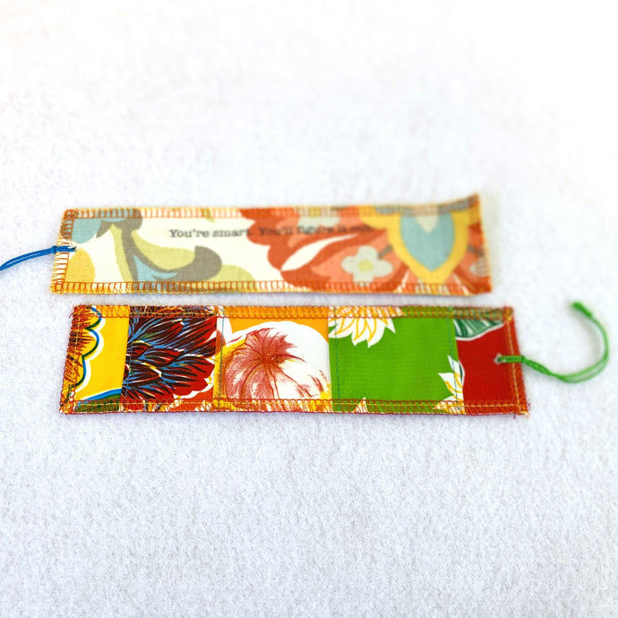 Front and back of oilcloth Fortune Bookmark from Tallulah Art•Head