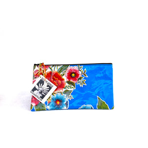 Small blue oilcloth pouch with red flowers from Tallulah Art•Head