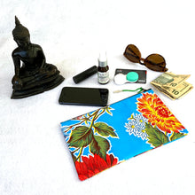 Load image into Gallery viewer, Small fuschia oilcloth zipper pouch with milagro zipper pull from Tallulah Art•Head with sunglasses, contact lens case, credit card, lipstick, cell phone and face toner spray.