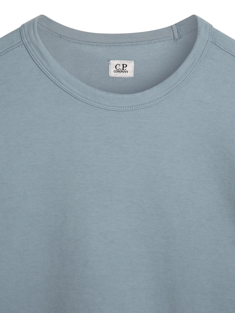 C.P. Company Garment Dyed Light Fleece Lens Sweatshirt in Blue