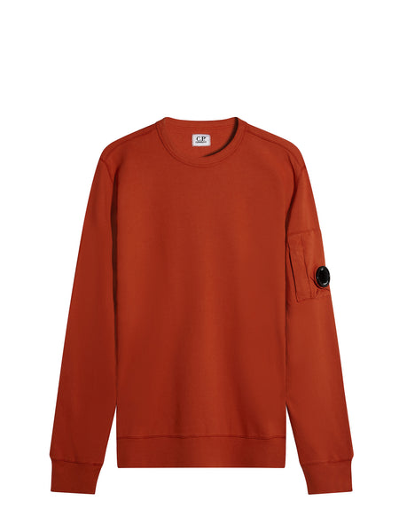 C.P. Company Garment Dyed Light Fleece Lens Sweatshirt in Orange