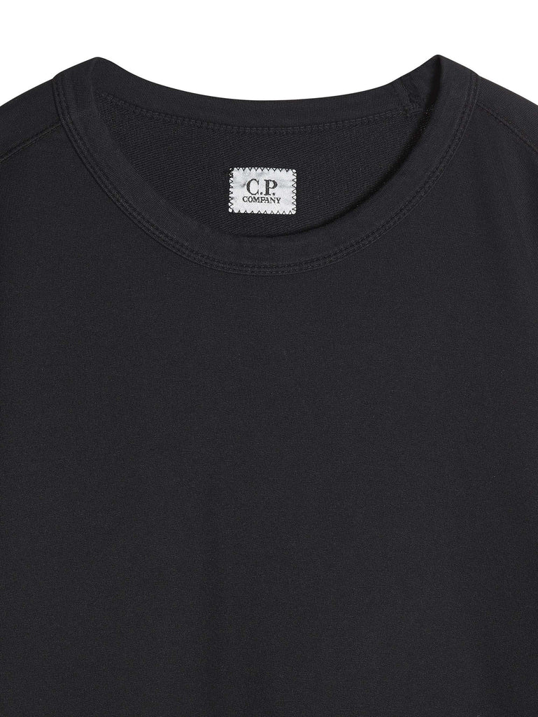 C.P. Company Garment Dyed Light Fleece Lens Crewneck Sweatshirt in Black