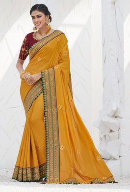 Mustard Yellow Satin Georgette Heavy Thread Embroidered lace work Saree with Embroidered Blouse