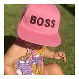 Baby BOSS cap on baby girl in pink