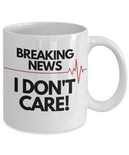 Load image into Gallery viewer, Breaking News, I Don't Care Funny Coffee Mug. Gag Gift Novelty Item. 11 Oz.