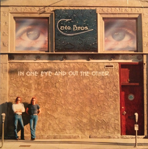 Cate Bros ‎– In One Eye And Out The Other