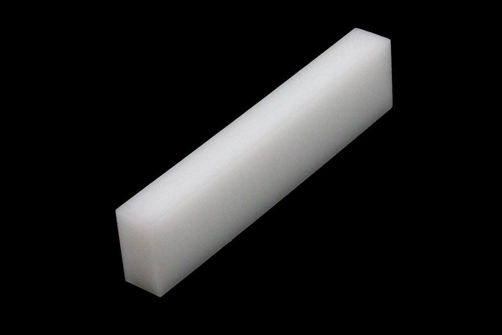 Large Polyester Nut Blank - 2-1/8 x 15/32 x 1/4 inches.