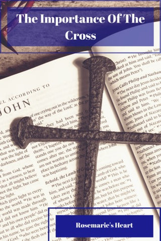 a cross on a bible the importance of the cross by rosemarie's heart