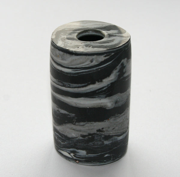 Small cylindrical black and white inkwell