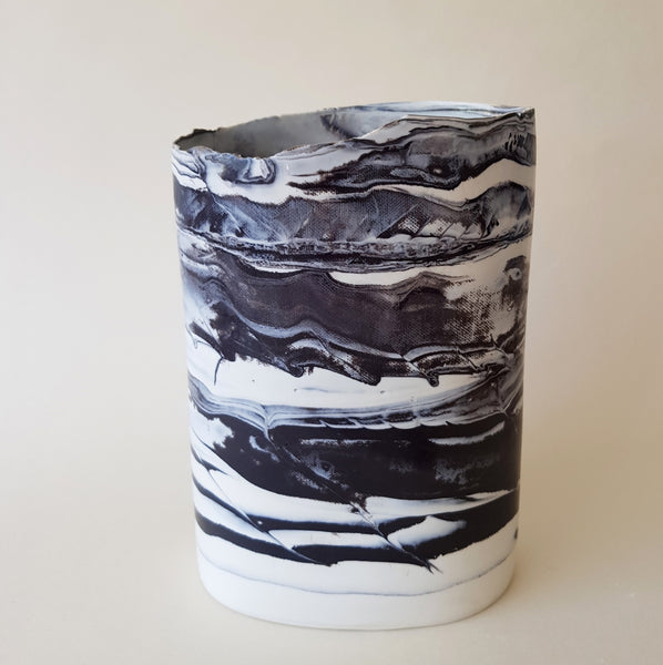 black and white oval porcelain vessel