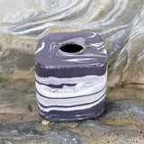 Small square black and white inkwell with handmade glass stopper on the rocks which inspired this series.