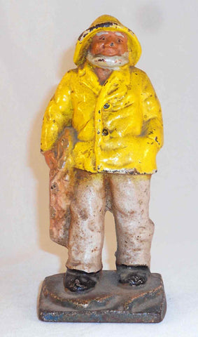 Antique Heavy Cast Iron Doorstop Fisherman or Old Salt in Yellow Jacket and Hat