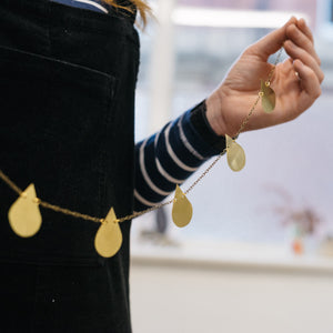 Brass teardrop garland made with wall hanging kit