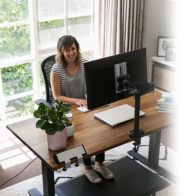 Lady Sitting at Recycled Messmate Sit-Stand Desk