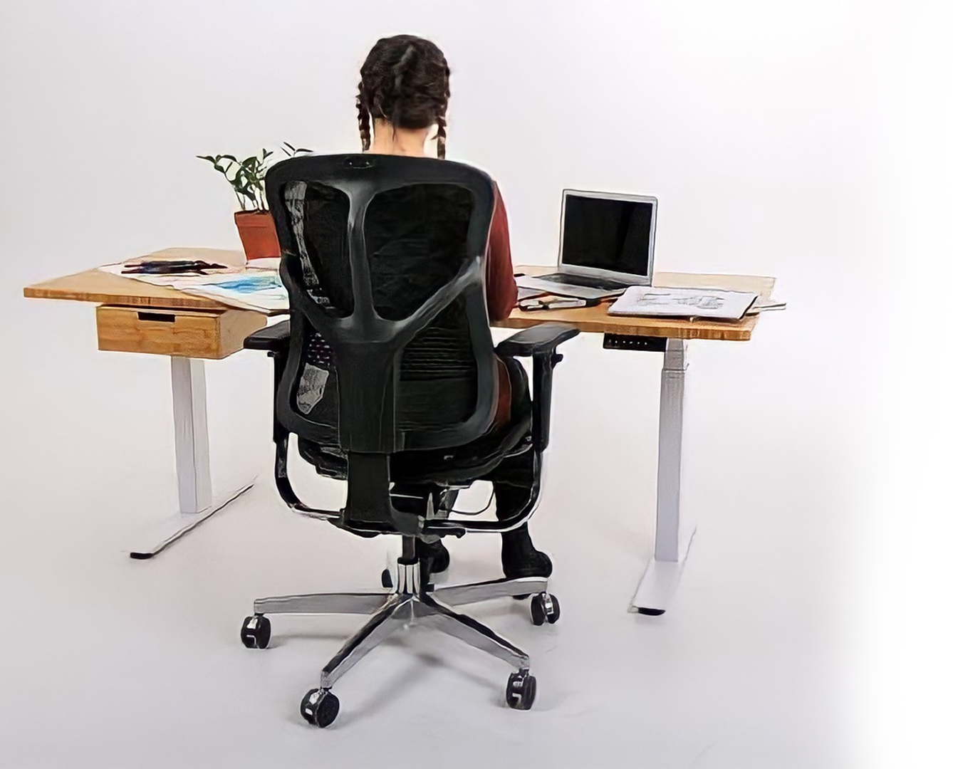 Lady Sitting at Bamboo Sit-Stand Desk