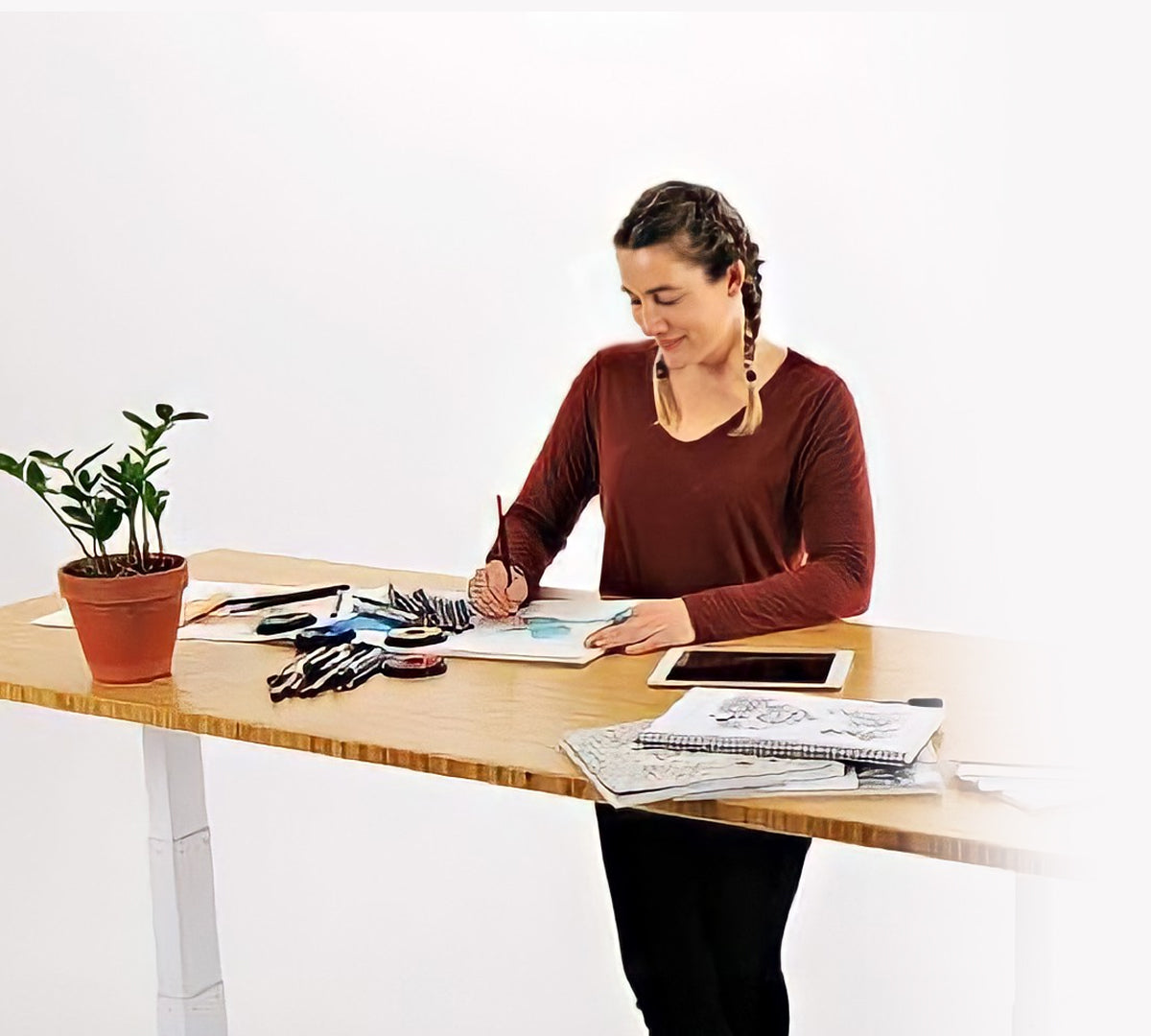 Lady Standing at Bamboo Sit-Stand Desk