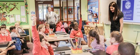 Picture of CEO Sophie Deen in a classroom with kids teaching them about Agent Asha and the Children's Intelligence Agency, and coding through narrative storytelling