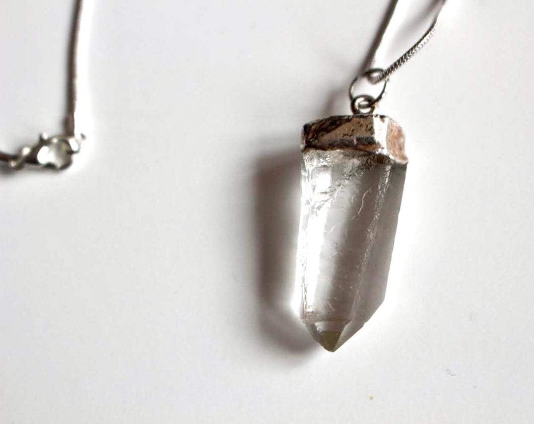 Unique piece of crystal quartz hanging from a silver chain