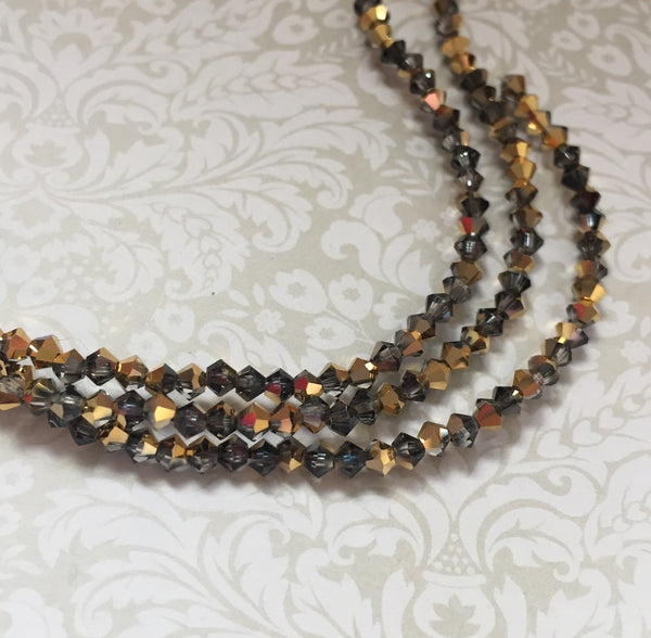 Crystal Aurum MC Bicone 3 mm Beads Strand of 42