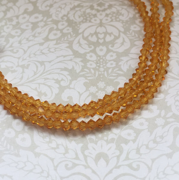 Topaz MC Bicone 3 mm Beads Strand of 42