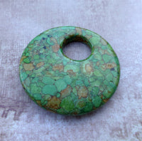 Dyed Synthetic Turquoise Doughnut Pendant