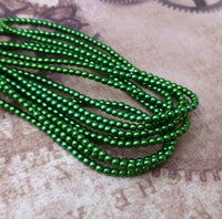 Strand of 150 Faux Pearl Beads Mini Glass Pearls Xmas Green 2mm