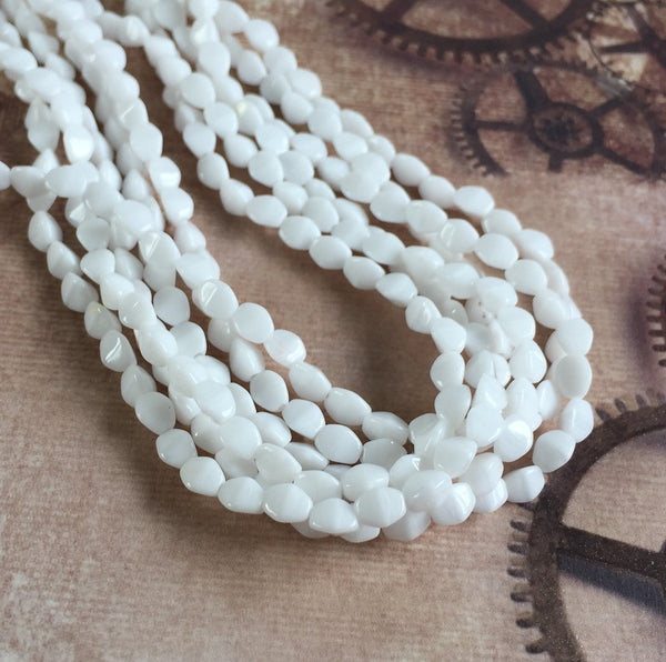 White 5mm Pinch Beads Strand of 50 Beads